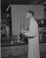 Mr. Grundemeier working in the Chemistry lab at Mankato State college, 01-08-1959.