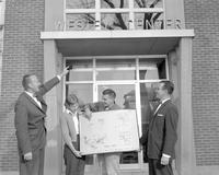 A four administrators in front of Wesley Center, Mankato State College, 1960-10-31