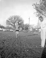 A student and his coach at an athletic practicing, Mankato State College, 1960-10-31
