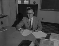 An accounting professor in his office, Mankato State College, 1960-10-31