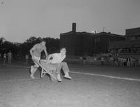 Wheelbarrow races at Mankato State College on June 30, 1958.