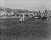 Action shot of Mankato State College football team versus opponent, 1958-11-06.