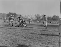 Action shots of Mankato State College football team and opponents, 1958-11-11.