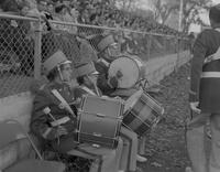 Band members cheer on players at a football game, Mankato State College, 1958-11-11.