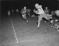 Action shot of football players at Mankato State College, 1958-11-18.
