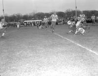 Action shot of Mankato State College football team versus River Falls, 1958-12-04.