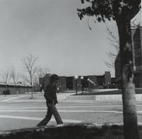 Mankato State College students walk across the mall.  Trafton Science Center in background, Nelson Hall on left, and Armstrong Hall on right in the background.