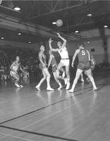 Mankato State College basketball team plays against St. John University at Mankato State College, 1958-12-08.