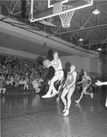 Mankato State College basketball players in action against Moorhead, 1959-01-23.