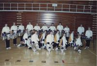 Members from the Mankato State University band posing for a picture in Otto Recreation Center, 1980s.