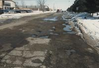 A winter shot of Stadium Road looking at the potholes, Mankato State University, 1989.