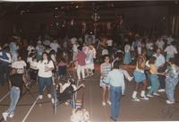 People dancing at the National Cerebral Palsy Games, Otto Recreation Center, Mankato State University, July 16th, 1989.