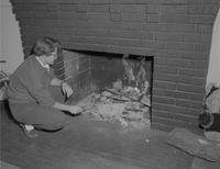 A student and a fireplace, Mankato State College, 1959-01-30.
