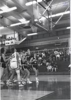 Players from both teams packing the lane as the ball reaches the rim during a game at Mankato State University