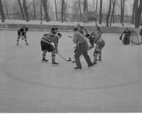 Action shot of Mankato State College hockey game against Gustavus, 1959-02-10.