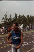 A picture of a man running in the 1989 Mankato State University National Cerebral Palsy Games.