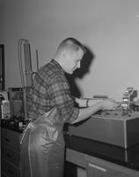 Lynn Walker works with chemistry equipment at Mankato State College, 1959-03-10.