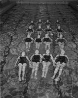 Dolphins doing back float at Mankato State College, 1959-03-10.