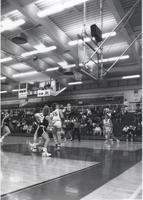 Players watching the ball and getting in position for a rebound during a game at Mankato State University