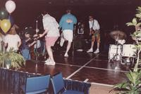 Band members on a stage play for an audience during an event in the Centennial Student Union Ballroom at Mankato State University, 1980s.