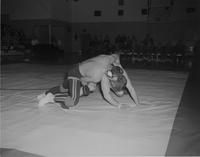 A wrestling competition, Mankato State College, 1959-03-16