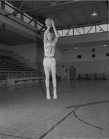 A basketball player practicing in the Myers Field House, Mankato State College, 1959-03-19