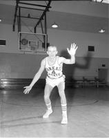 A basketball player in a defense position in the Otto Arena at Mankato State College, March,19,1959.