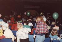 A group of people seated and being seated at an event in the Centennial Student Union Ballroom at Mankato State University, 1980s.
