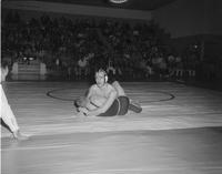 Action shot of wrestlers at Mankato State College, 1959-03-16.