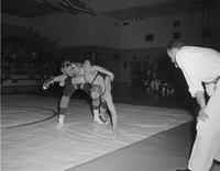 Lowell Glynn in action at wrestling tournament at Mankato State College, 1959-03-16.