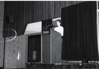 Woman giving a speech inside the ballroom in the Centennial Student Union at Mankato State University