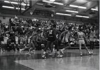 Maverick players turning around to head back on defense after a made basket during a game at Mankato State University