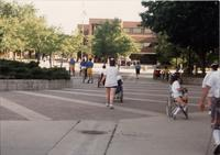 People walking through the Campus Mall, National Cerebral Palsy Games, Mankato State University, July 14th, 1989.
