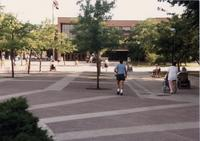 People walking through the Campus Mall.  National Cerebral Palsy Games, Mankato State University, July 14th, 1989.