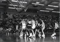 Players from both teams going after a ball in the middle of the lane during a game at Mankato State University