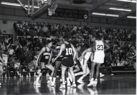 Maverick players going back on defense after making a shot during a game at Mankato State University
