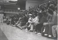Picture of the crowd as MSU Mascot, Stomper, walks by during a game at Mankato State University