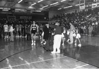 Players from both teams shaking hands after the game at Mankato State University