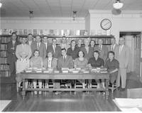 Mankato State College faculty pose in the library on November 4, 1958