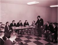 Delta Sigma Pi members at meeting with advisor at Mankato State College 1965-01-22