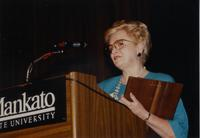 A woman, speaking while holding a plaque.at the Mankato State University Retirement Banquet in the Centennial Student Union Ballroom 06-01-1989.