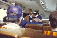 A photo of Mankato State University fans as they ride a charter bus to the conference championship football game, 1987.