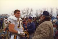 A Mankato State University football player talking to a fan after the conference championship game at South Dakota State University, 1987.