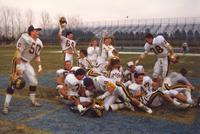 Mankato State University football players and cheerleaders celebrate after a win against South Dakota State University at the conference championship game, 1987.