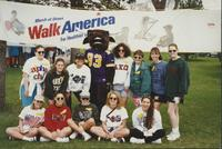 Members of different sororities taking a group picture during the March of Dimes Walk America event at Mankato State University