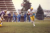 A Mankato State University football player anticipates the moves of an Augustana Viking during a football game at Blakeslee Stadium, 1987.