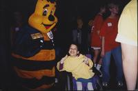Child posing with the Old Country Buffet Bee at an event at Mankato State University