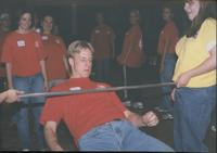 Student seeing how low he can go during a round of limbo at Mankato State University