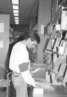Library worker shelving items in Memorial Library at Mankato State University
