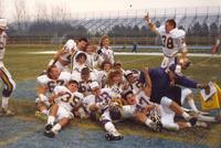 Mankato State University football players, cheerleaders, and coach celebrate after a win against South Dakota State University at the conference championship game, 1987.